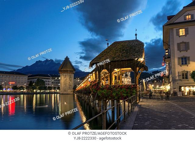 Historical Chapel Bridge, a landmark at the city of Lucerne at the Lake Lucerne at night, Switzerland