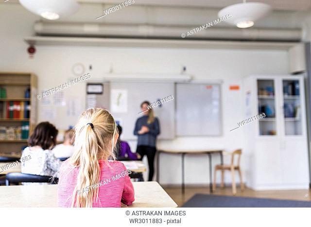Girls (8-9) sitting in classroom