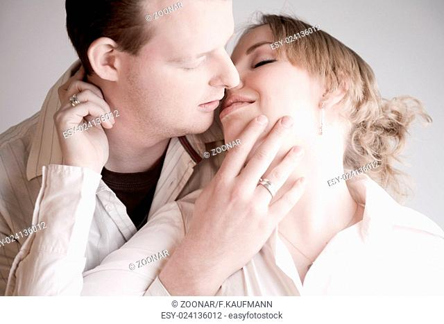 Portrait of a young kissing couple