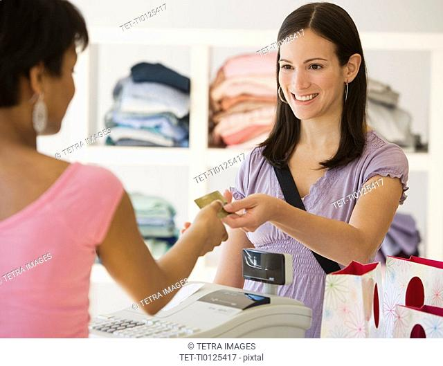 Woman paying at clothing store