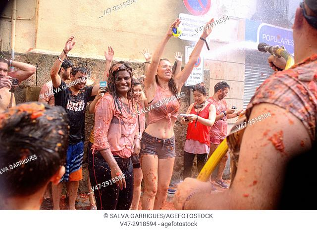 Young people enjoying the Tomatina, the world's largest tomato fight, Tomatina, Buñol, Valencia, Spain