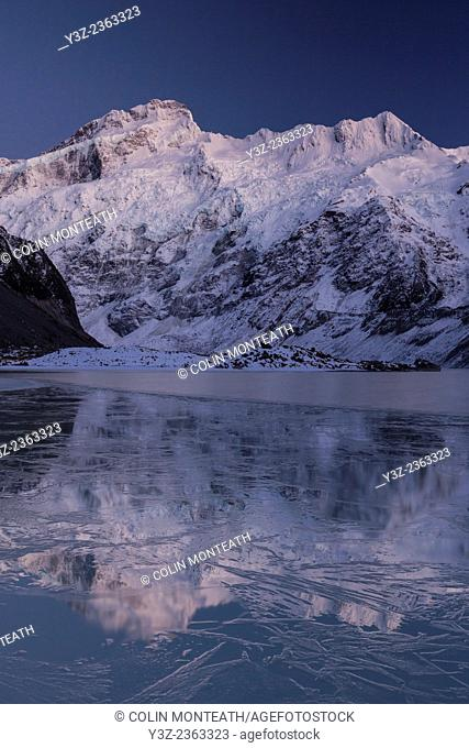 Mount Sefton reflection in ice covered Mueller lake, Aoraki Mount Cook National Park, Canterbury