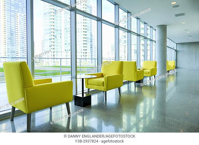 Bright yellow chairs in the hallway of a modern hotel