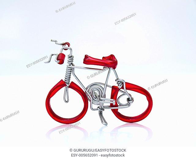 A red miniature bike handicraft model from Thailand