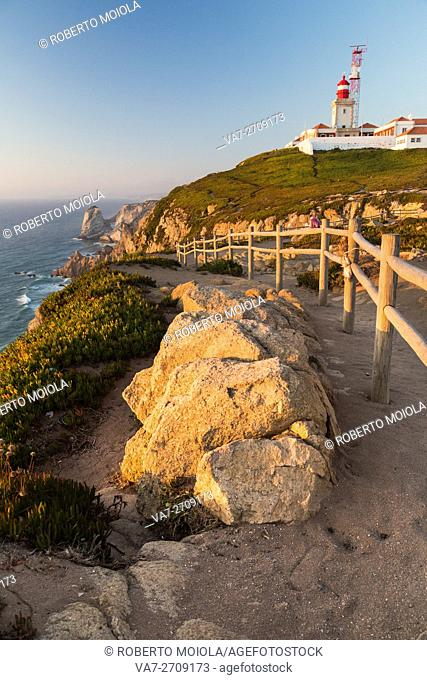 The colors of the sunset on the cape and lighthouse of Cabo da Roca overlooking the Atlantic Ocean Sintra Portugal Europe