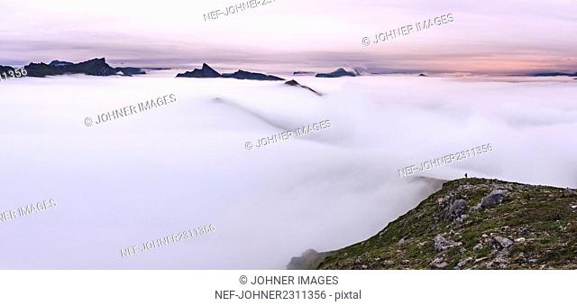 Foggy mountain landscape at sunrise