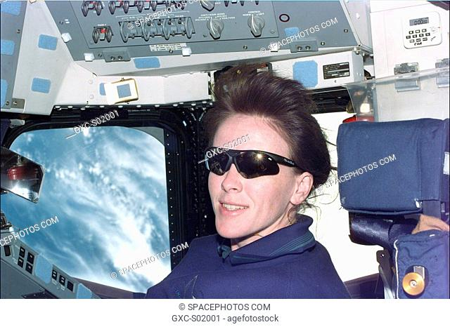 Astronaut Janet L. Kavandi, mission specialist, sports a pair of sunglasses while looking at the bright Earth aboard Endeavour's flight deck