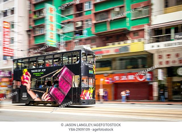 Motion blur pan, double-decker tram passing on Hennessy Road, Wan Chai, Hong Kong Island, Hong Kong, China