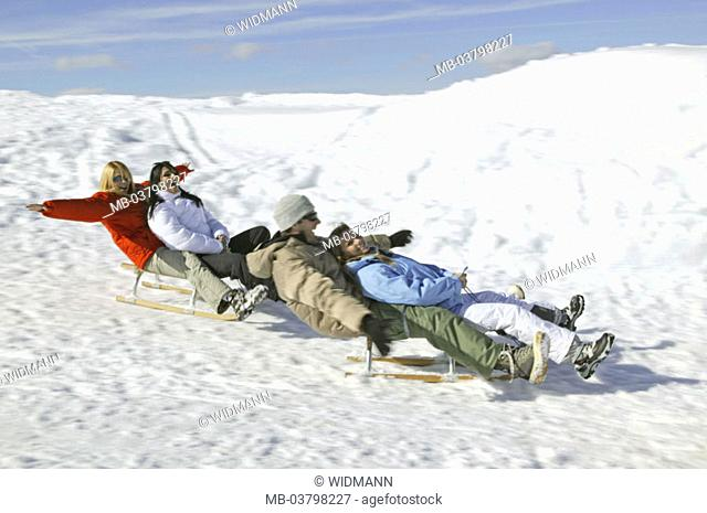 Man, women, young, happy,  Sleds, side view, Snow, winters, Winter landscape, 20-30 years, winter clothing, clique, friends, happily, mood positively, sleighs