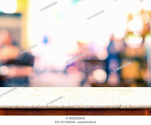 Empty marble table top and blurred coffee shop bokeh light in background, Mock up for display of product
