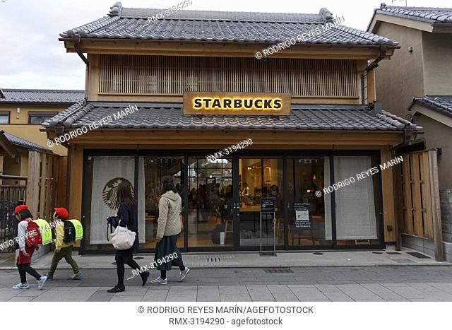 December 5, 2018, Saitama, Japan - Pedestrians walk past a Starbucks coffee shop at Kanetsuki Street in Kawagoe. The branch opened last March is located near to...