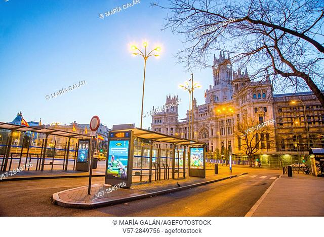 Bus stops at dawn. Cibeles Square, Madrid, Spain