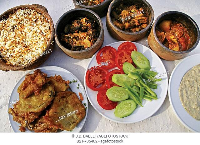 Fried aubergines, salads, 'babaghanouch',  rice and different vegetables stews..... Egypt