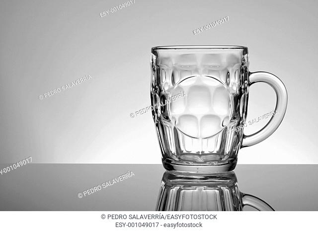Large empty glass jar on a white background