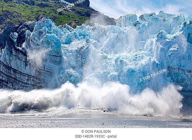 Icebergs calving with splash from the glacier, Margerie Glacier, Glacier Bay National Park, Alaska, USA