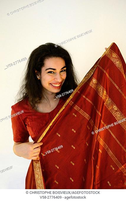 India, Rajasthan, Jaipur, Ishta putting on a sari