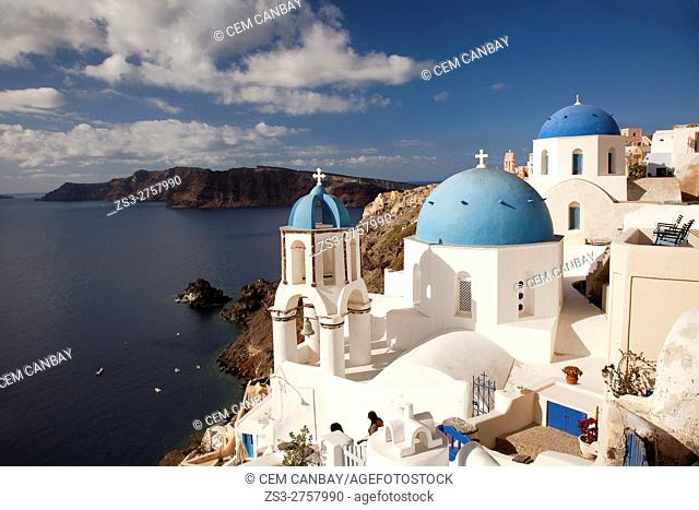 Blue domed churches at the cliff in Oia village with Caldera at the background, Santorini, Cyclades Islands, Greek Islands, Greece, Europe