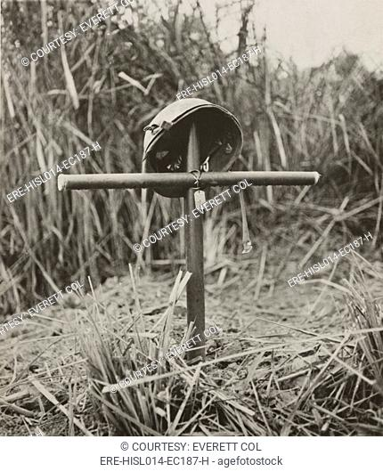 Helmet and dog tags of Sgt. Lionel J. Paquette on a cross made from bamboo, in Burma Myanmar. He was a World War II special forces soldier with Merrill's...