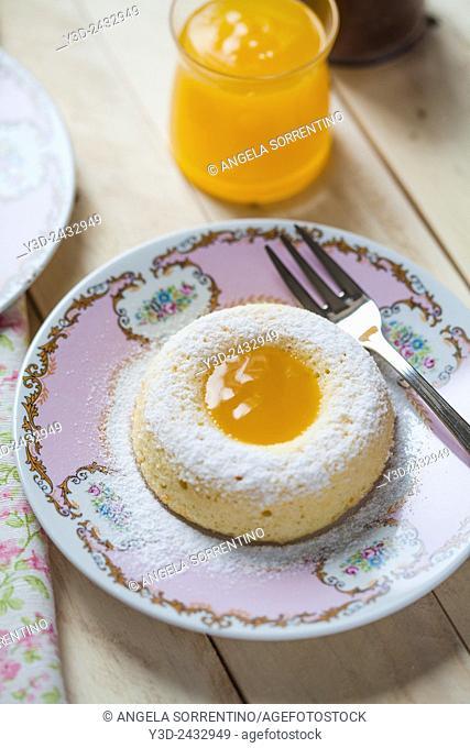 ring-shaped cake with orange cream