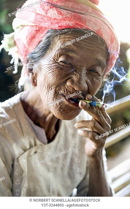 Myanmar (ex Birmanie). Inle lake. Woman smoking the cheroot the Burmese cigar