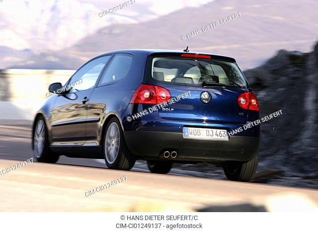 VW Volkswagen Golf GT 2.0 TDI, dark blue, model year 2005-, driving, diagonal from the back, rear view, country road
