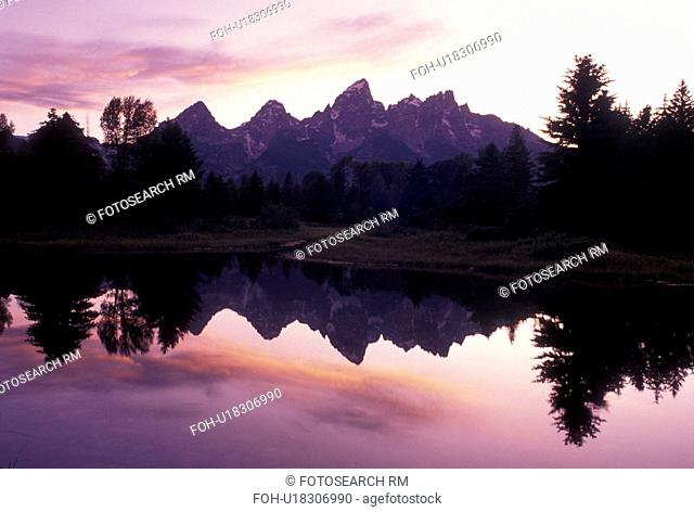 sunset, Grand Teton National Park, Snake River, Jackson Hole, WY, Wyoming, Scenic view of the Grand Teton Mountains reflecting in the calm waters of the Snake...