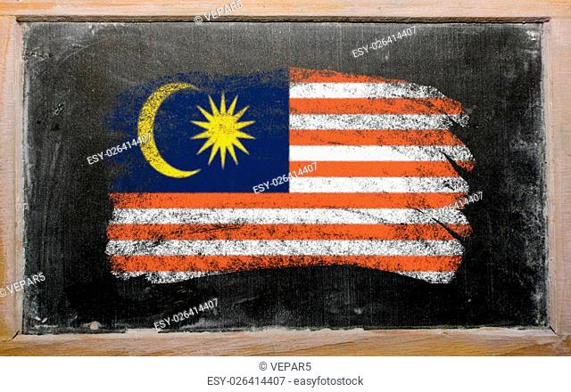 Chalky malaysian flag painted with color chalk on old blackboard