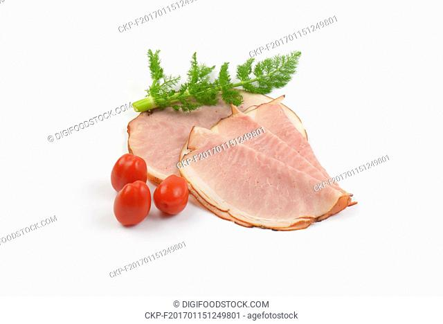 ham slices with fresh dill and cherry tomatoes on white background