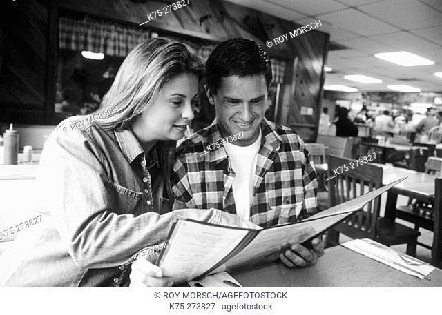 Couple looking at the menu