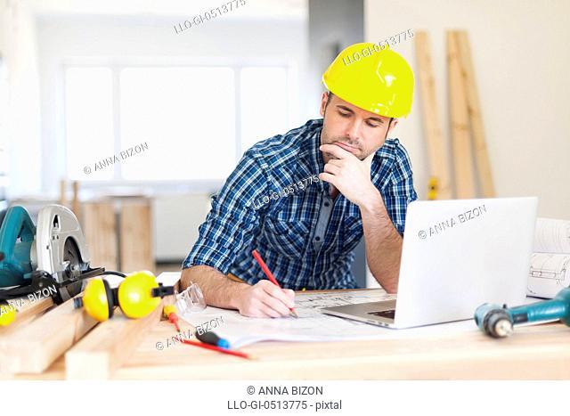 Focus construction worker on construction site. Pilzno, Poland