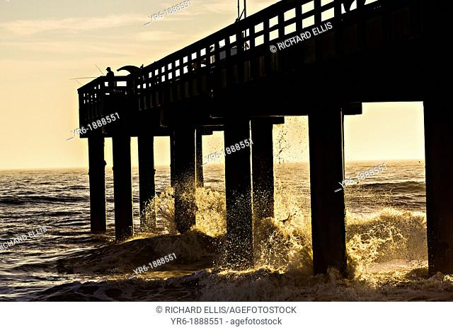 Sunrise over a fishing pier on St Augustine Beach, Florida