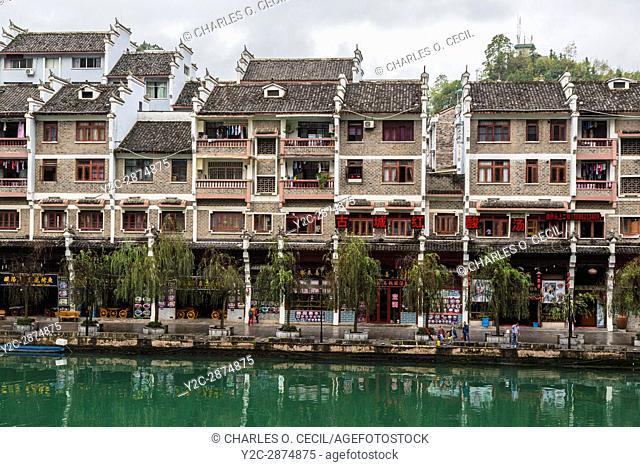 Zhenyuan, Guizhou, China. Apartment Housing along the Wuyang River