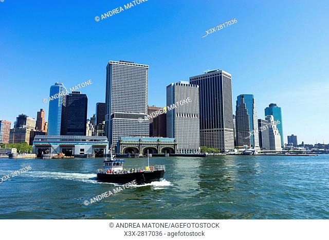 Boat crossing in front of the Manhattan skyline. Battery park. New York city. USA