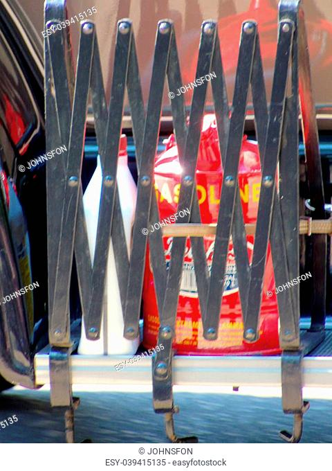 Gas can and other dangerous liquids behind metal gate on old fashioned fire truck