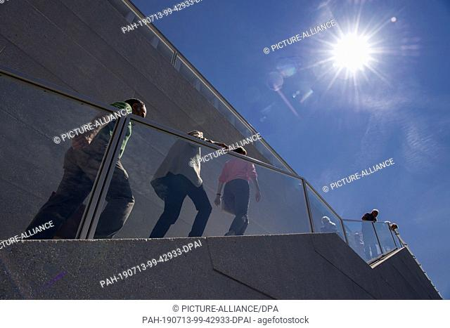 13 July 2019, Berlin: After the opening of the James Simon Gallery, visitors go up the stairs along the banks of the Spree
