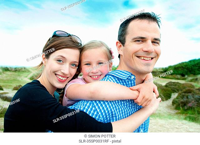 Family hugging on beach