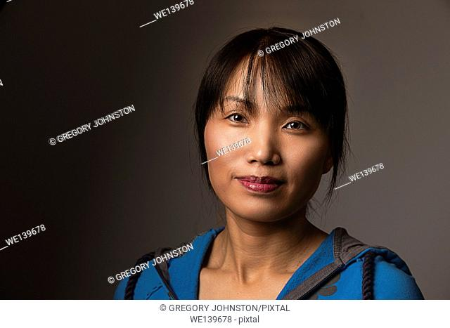 A pretty middle aged Korean woman in casual style