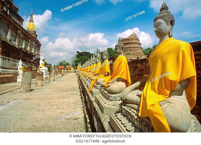 Buddhas, Ayutthaya, Thailand, draped in gold cloth on eve of Buddha's birth