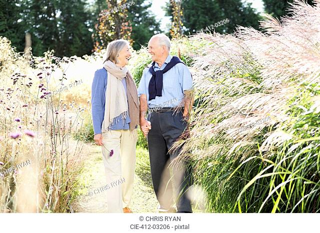 Older couple walking outdoors