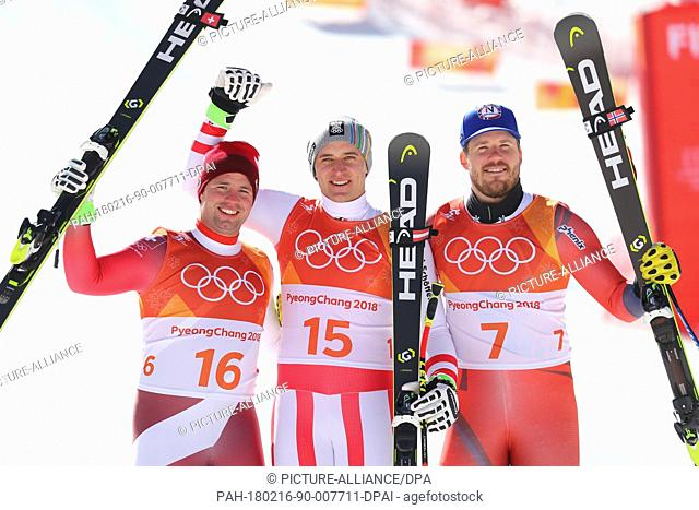 Beat Feuz (silver, L-R) of Switzerland, Matthias Mayer (gold) of Austria and Kjetil Jansrud (bronze) of Norway at the award ceremony after the men's Super G...