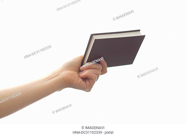 Woman Hand Holding Notebook