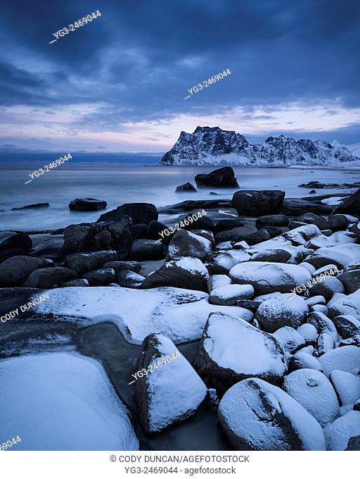 Rocky shore of Uttakleiv beach in winter, Vestvågøy, Lofoten Islands, Norway