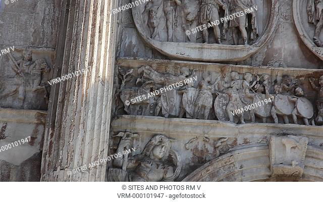 Daylight, PAN, TILT up, CU on the left side of the south face of the triumphal arch. It was built in 315 AD and consists of three archways