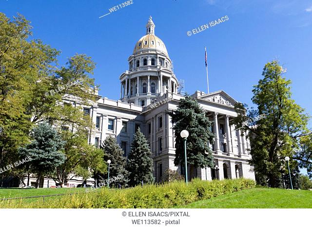 Front of the Colorado state capitol building with gold dome taken from side lawn