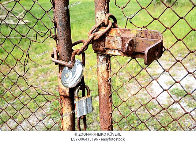 locked gate on a private plot