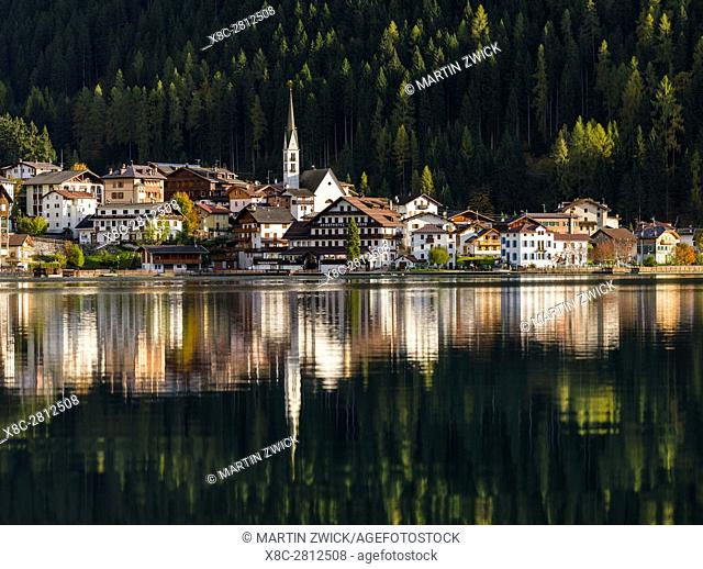 Village Alleghe at Lago di Alleghe at the foot of mount Civetta, one of the icons of the Dolomites of the Veneto. The Dolomites of the Veneto are part of the...