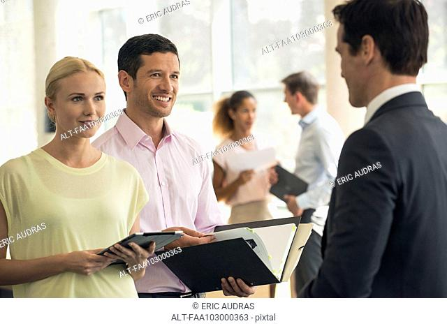 Salesman meeting with clients