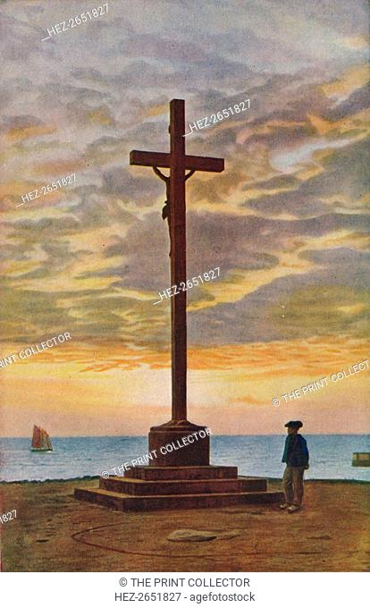 'Brittany. All over the Land of Pardons symbols like this fine crucifix beside Concarneau Bay express the soul of a religious people', c1920