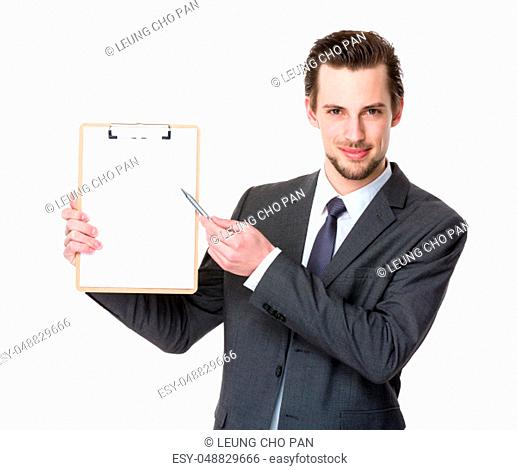 Young businessman with pen point to clipboard