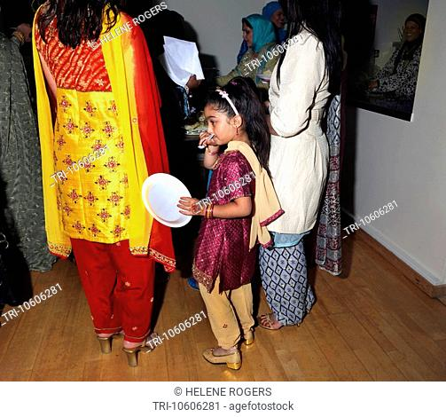 Eid Party at St Josephs Church Hall Epsom Surrey Child Queuing for Food